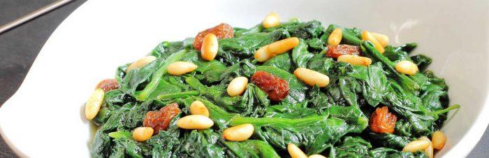 Saute di spinaci pinoli e uvetta